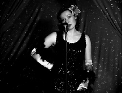 "A film still from a silent film, where I played a singer. Here I was ""pretending"" to sing."