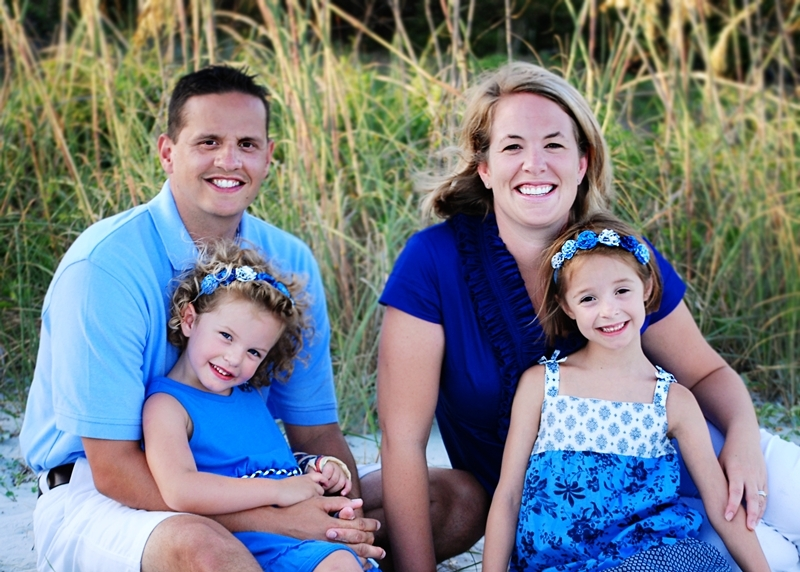 Jason Fine enjoys a family vacation with wife Meredith and daughters Amelia (left) and Madeline (right).