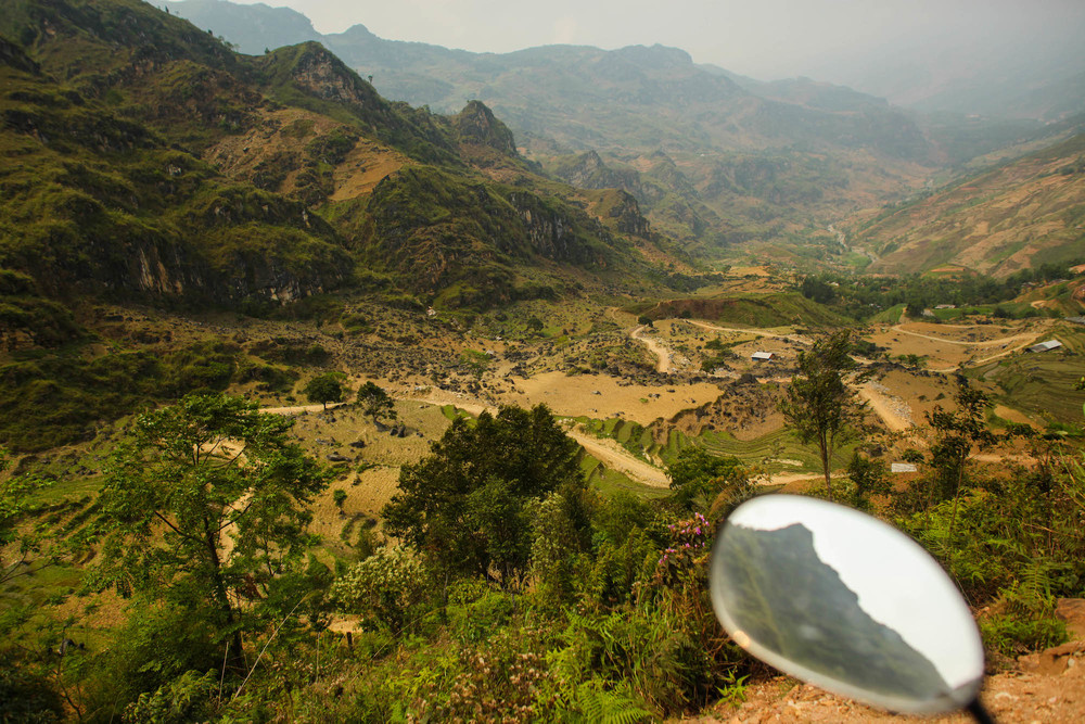 Going the wrong way down into a valley north of Bac Ha...we have to come back up this road almost out of petrol