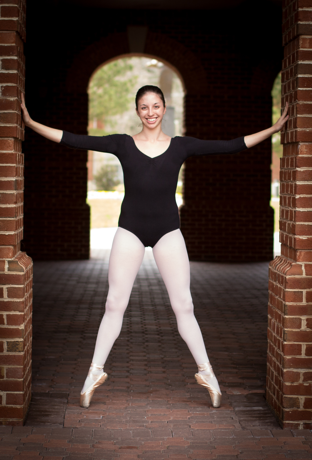 Christa asked me to do her senior portraits for the end of her undergraduate career. She wanted to do something different than the traditional portrait shoot and opted to have them done in her pointe shoes!