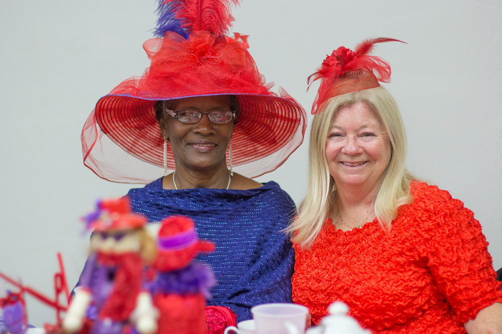"""Mamie""(left) won the best hat contest. I think it's easy to see why; that is a magnificent hat."