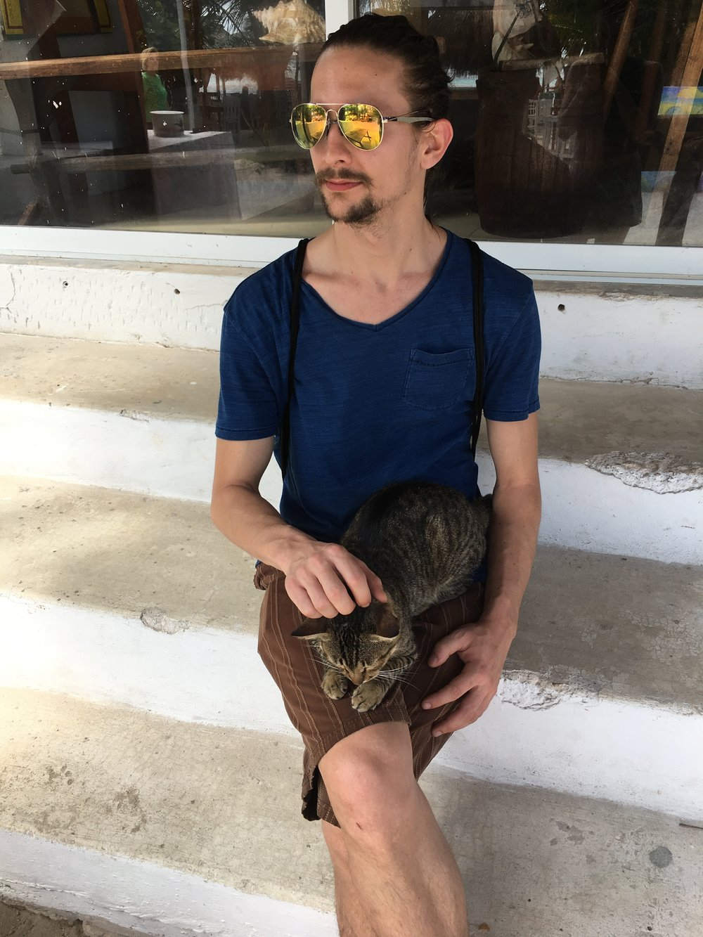 We found a kitty in Costa Maya. Here he is sitting on Mark, much like Sam is currently sitting on me and making it hard for me to type.