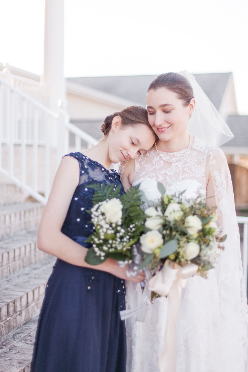 bride and her little sister winter wedding bridesmaid