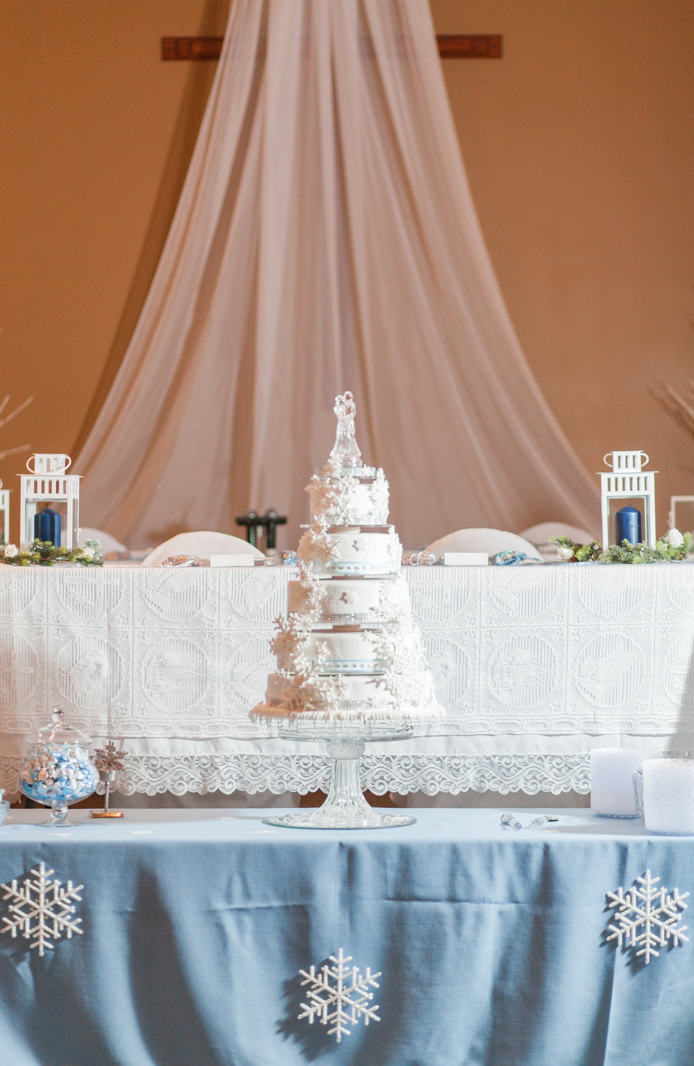 winter wedding snowflake cake with glass topper to look like ice