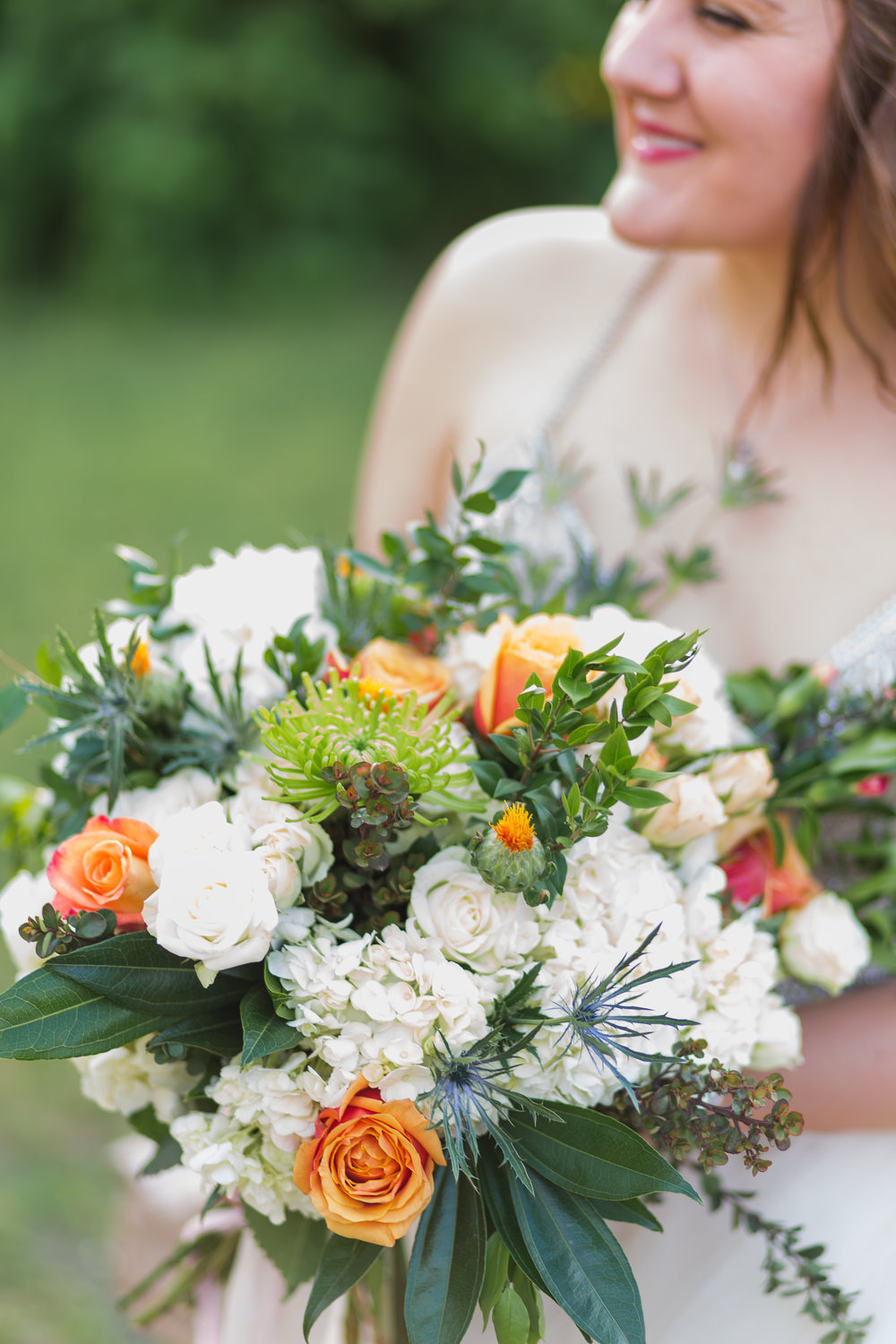 And check out her bouquet. She wanted peonies in it, and we almost took the ones from my peony bush, but she used hydrangeas instead, and it turned out beautifully!