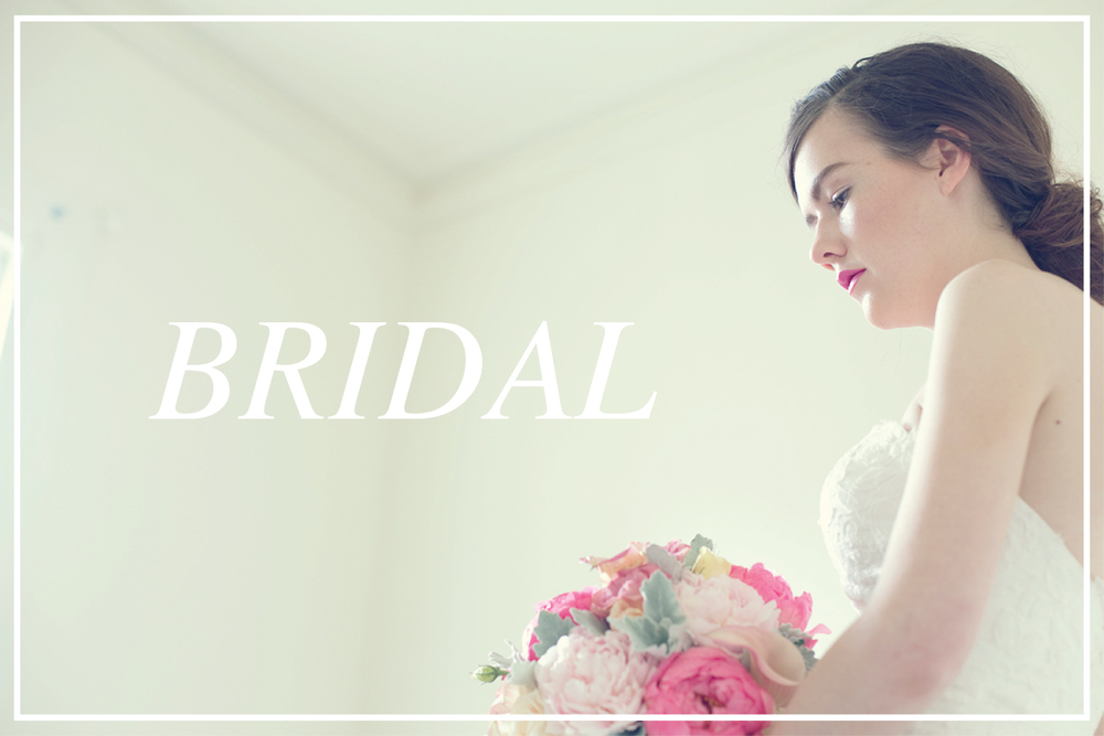 Natural wedding makeup with a pop of pink on lips to match bridal bouquet and a soft, relaxed low bun.