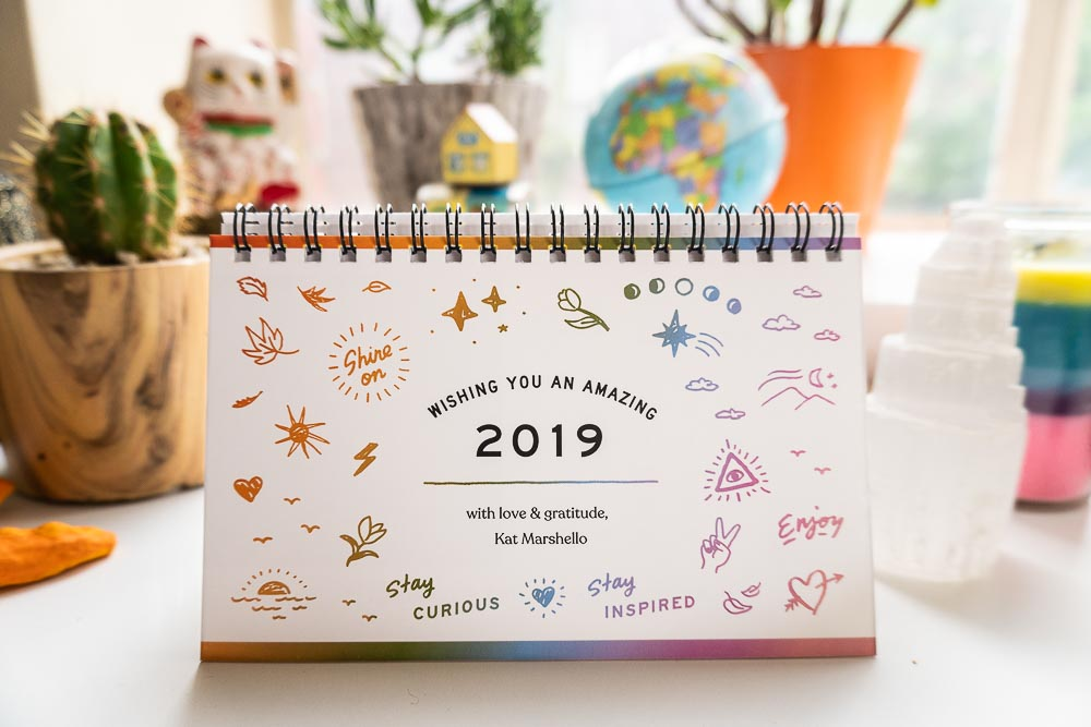 2019 calendar cover by Kat Marshello with rainbow hand drawn illustrations and lettering
