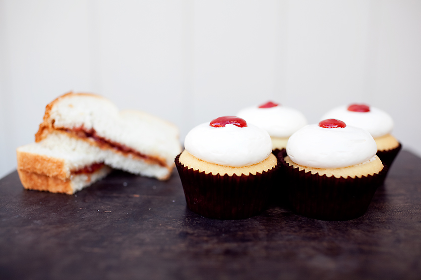 PEANUT BUTTER & JELLY our signature vanilla cupcake filled with strawberry jam, topped with peanut butter frosting