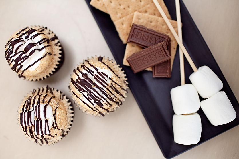 SMORE  our signature chocolate cupcake topped with buttercream, graham crumbs, mini marshmallows and drizzled chocolate