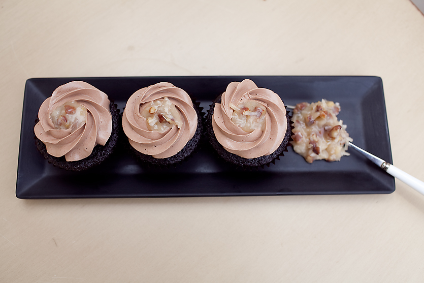 GERMAN CHOCOLATE our signature chocolate cupcake filled with coconut pecan filling, topped with chocolate buttercream