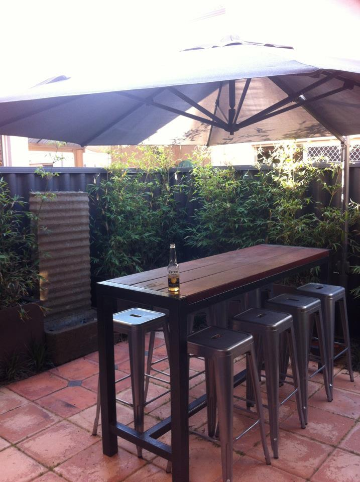 This is how the garden looked after one year...and how we use the courtyard in summer.  Umbrella up and an ice cold Corona.