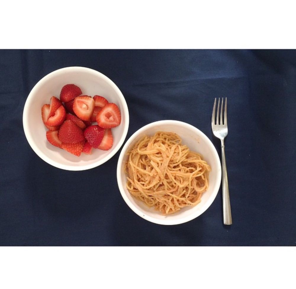 A nice bowl of spaghetti with creamy marinara sauce and fresh strawberries. The older boys got a sprinkle of cheese on top. Yum!
