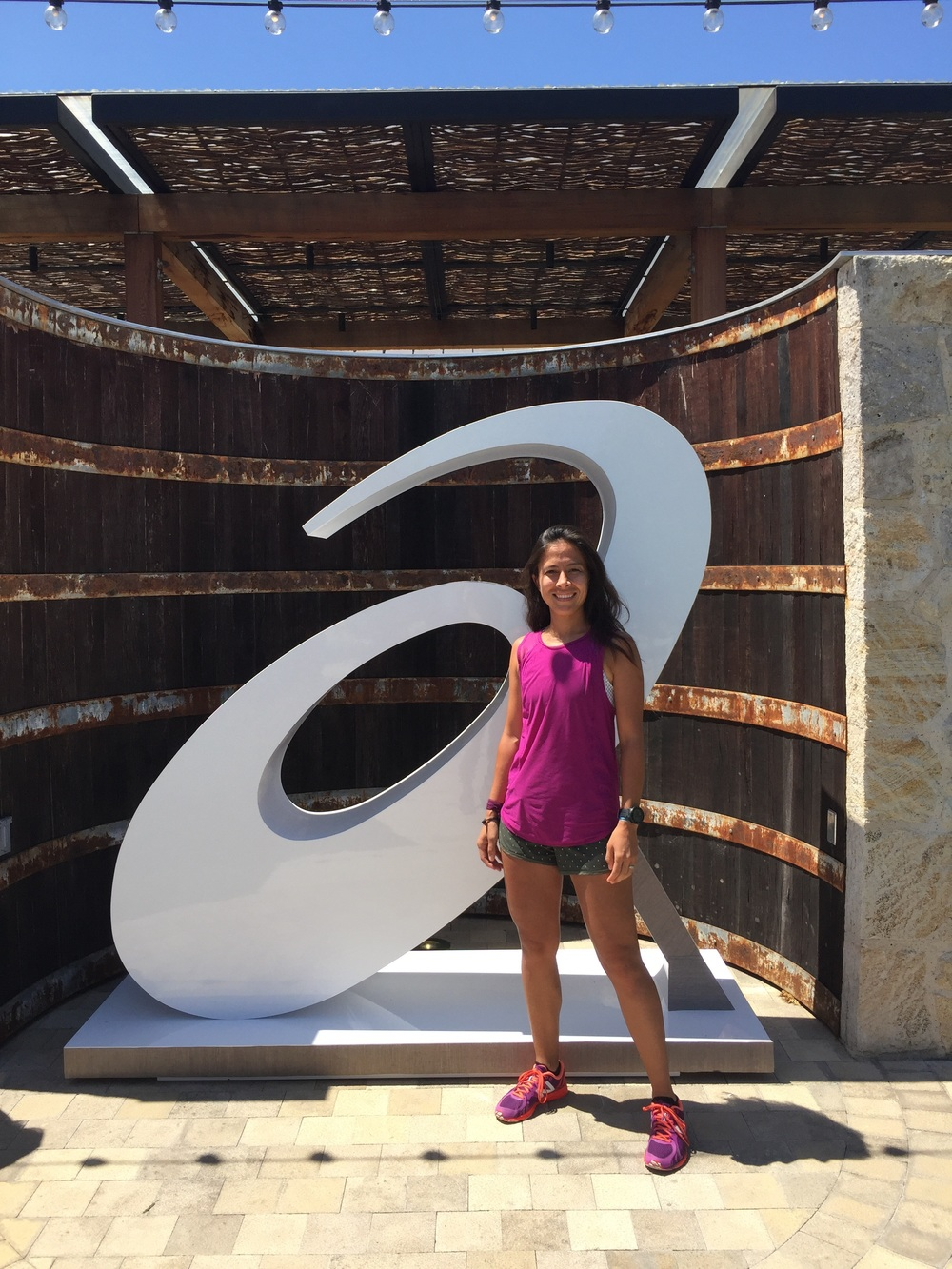 My picture in front of the asics logo wearing lululemon and new balance.