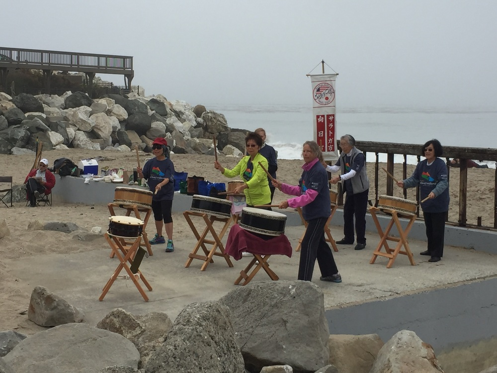 Taiko drummers. They were playing on the beach with the ocean behind. So great!