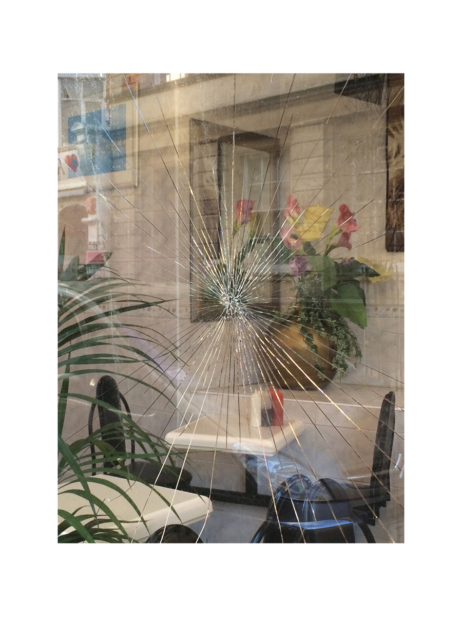 Smashed cafe window //