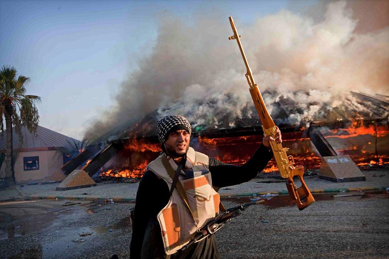 Fighters looted the compound and destroyed a Gaddafi statue    Times photographer, Jack Hill