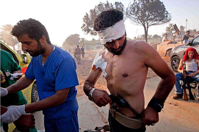 Wounded fighters in the compound    Times photographer, Jack Hill