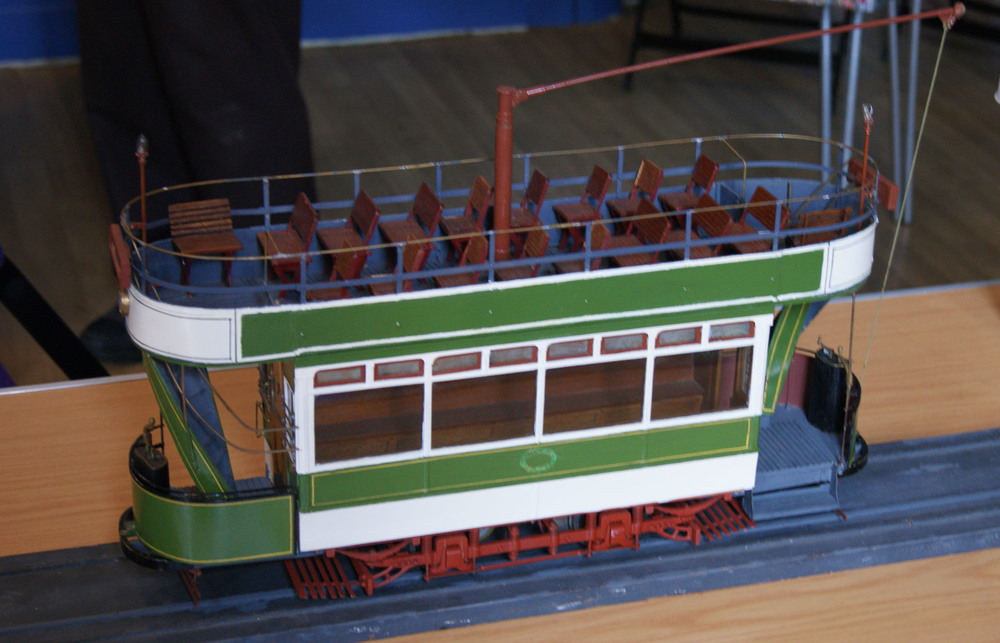 "A much-admired exhibit was John Buckle's model of a Chatham tram. Built to a scale of 3/4"" to the foot it represents number 15, one of the first batch of trams, supplied by Milnes in 1902. John conducted considerable research to establish the details, not the least being the livery. Is the brown colour of the trolley standard, seats and truck the origin of Chatham Traction's ginger brown?"