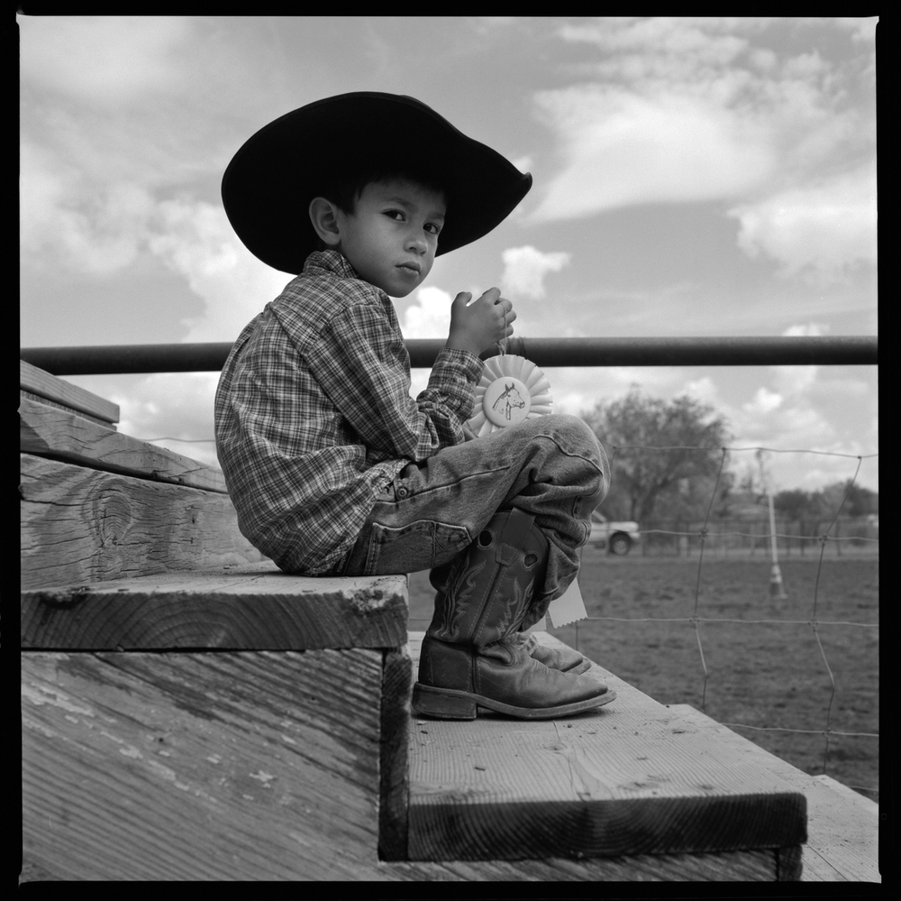 Young cowboy with first prize blue ribbon Ft. Davis, 2012   Made with Hasselblad 501c with Kodak Tri-X 400 b&w film