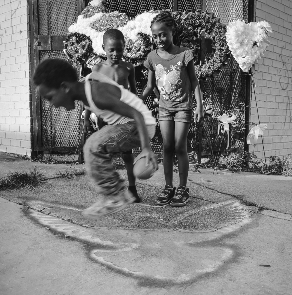 Kids playing aside a makeshift shrine New Orleans, 2014   Made with Hasselblad 501c with Kodak Tri-X 400 b&w film