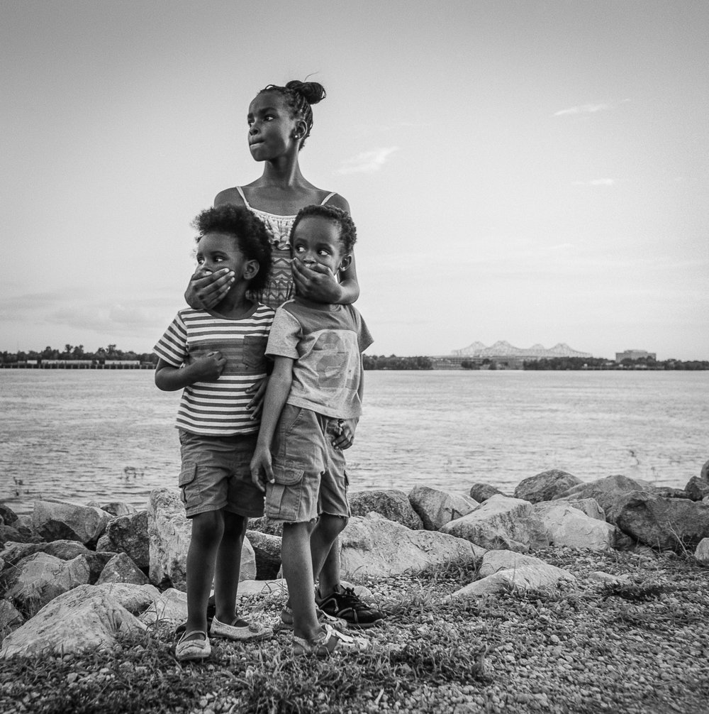 3 siblings along the Mississippi River New Orleans, 2018   Made with Hasselblad 501c with Kodak Tri-X 400 b&w film