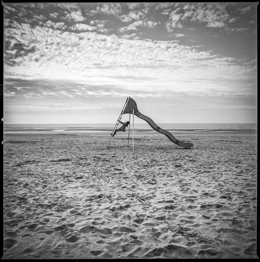 Girl on a slide Vierville-sur-Mer, France, 2013   Made with Hasselblad 501c with Kodak Tri-X 400 b&w film