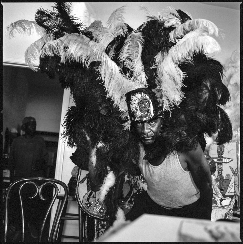 Slick, partially dressed in his Mardi-Gras Indian costume at his home New Orleans, 2015   Made with Hasselblad 501c with Kodak 120 Tri-X 400 b&w film