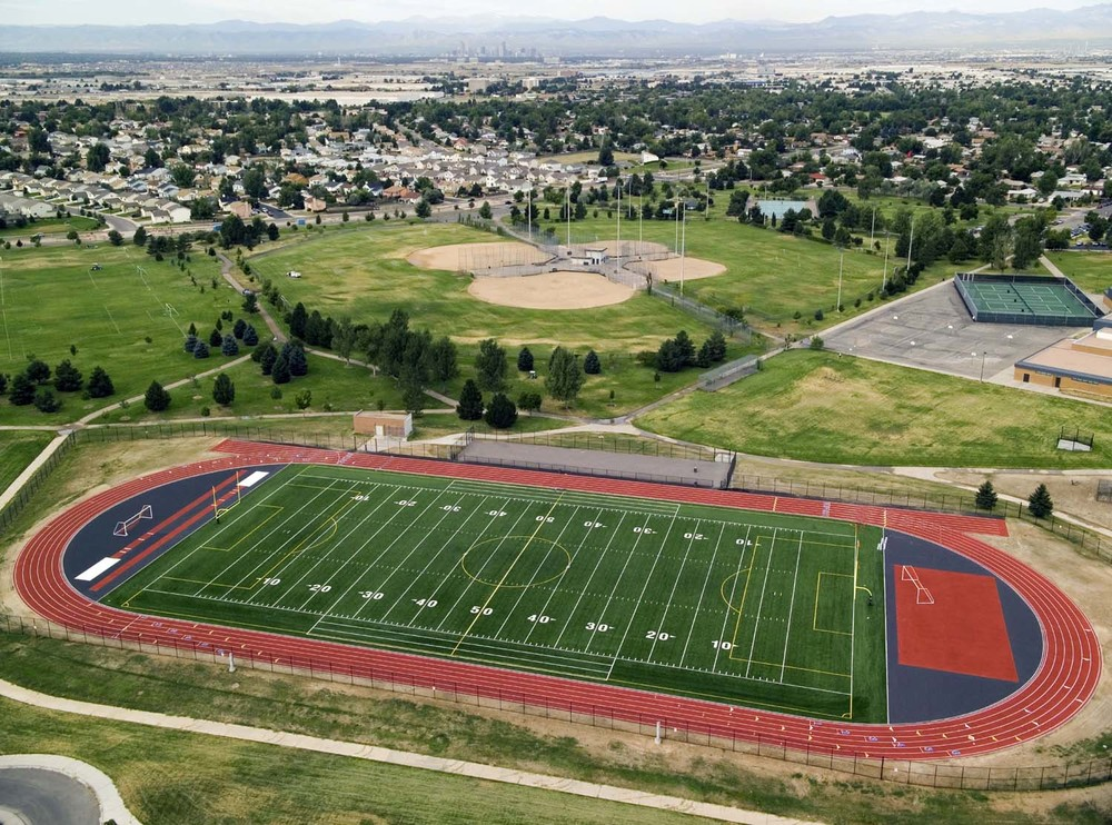 MONTBELLO FIELDS - Mechanical, electrical and site renovation of 6 schools, including the Montbello High School synthetic turf football field.
