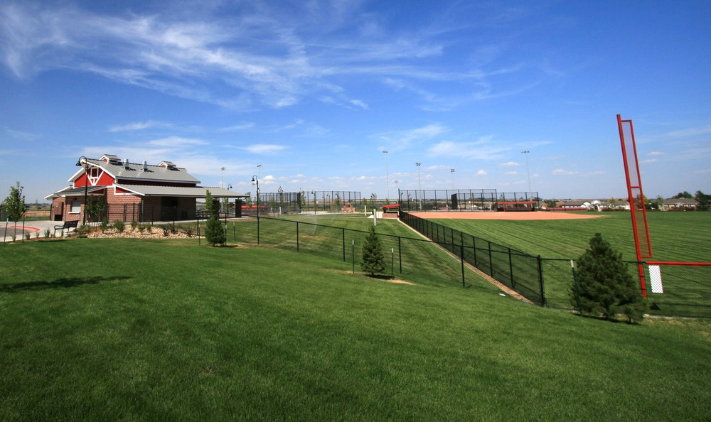NELSON PARK BALL FIELDS - Four ball fields, a concessions/restroom building, playgrounds, concrete sidewalks, sport lighting, and 2 parking lots. Project also included landscape, raw water irrigation, site grading and drainage, and sewer and water lines.