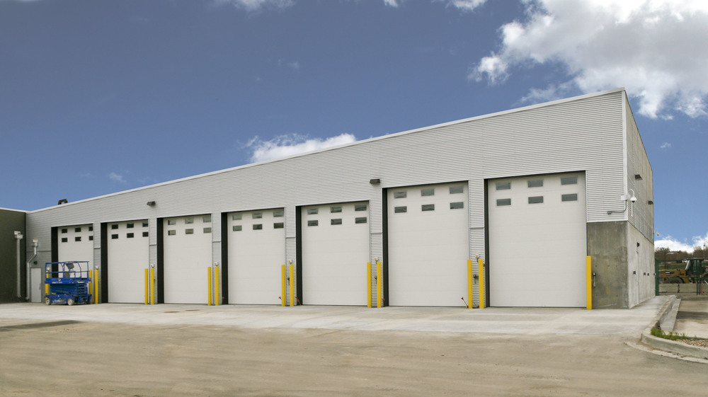 DPD COMMAND GARAGE  -  A 7,500 SF addition to the existing DPD firing range to be used for the storage of large command vehicles. The building is made of structural steel with a corrugated metal wall skin.