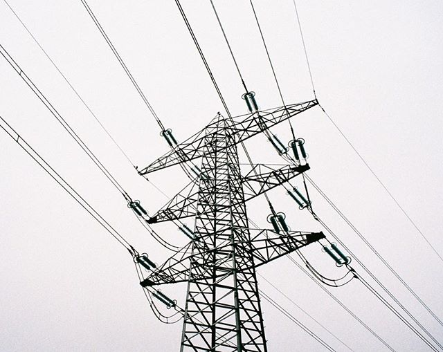 'The power of lines' 35mm photograph taken with my Pentax ME Super. #analoguephotography #filmphotography #35mmphotography #35mmfilm #filmcamera #pentaxmesuper #pentax #pylon #pylonography #powerlines #electricity #photography