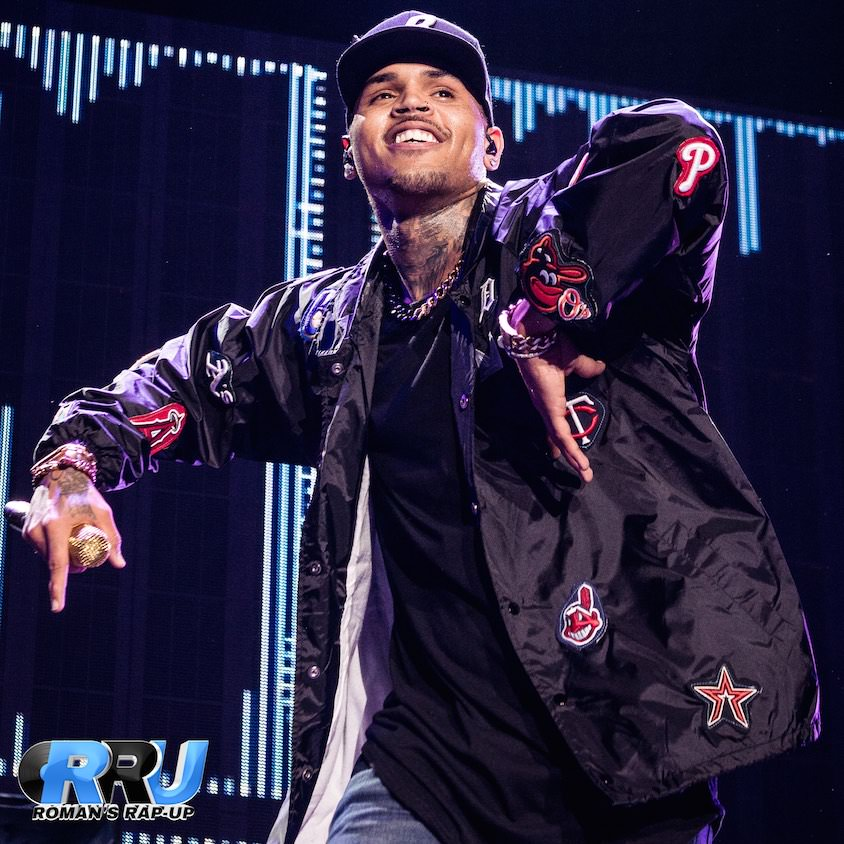"Chris Brown performing at The Forum in Los Angeles on March 8th, 2015 as part of the ""Between The Sheets"" tour (Michelle Kwong/Roman's Rap-Up)."
