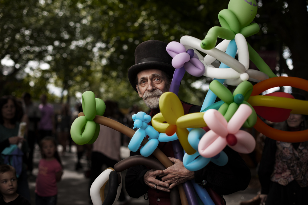 Michael and his wife Miriam are masters at twisting balloons, and they're great with a crowd. Michael was about ready to pack up and head home for the day, but was kind enough to take a few minutes to let me photograph him, while his line of impatient customers began to pile up.