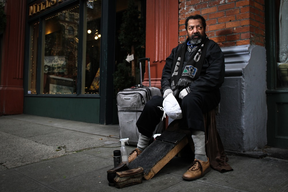 Robert shines shoes for a living, and he's a really nice guy. This was the third time I've photographed him. He never really talked much, but after I offered to bring him a prints of this photo, his face lit up, and we finally struck up a conversation. 2010.