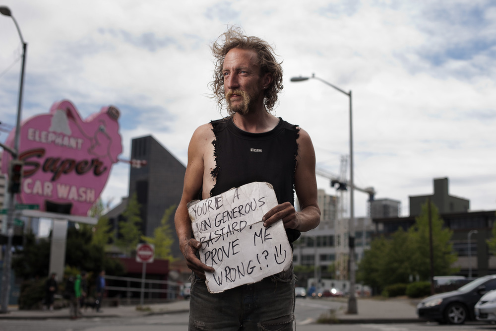 Shadow is a Seattle Native, who's been homeless for a few years now. He hangs out above the Highway 99 tunnel in downtown Seattle, where he helps locals get free parking through a secret trick he's learned with machines.