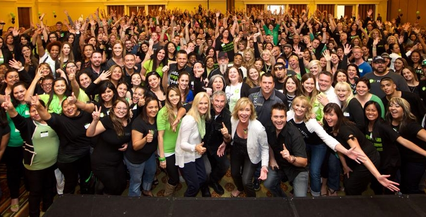 My Husband and I with It Works Global! Owners in front of one of my team training's!