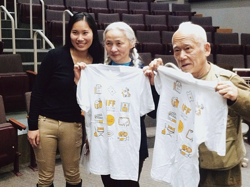 Noriko and Ushio Shinohara, of Cutie and the Boxer, with their shirts.