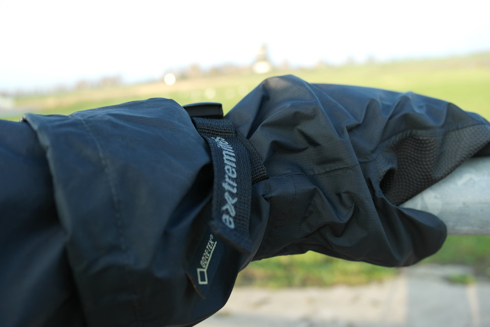 The gloves are big enough to wrap over or under the cuff of a jacket. This allows the hand to remain perfectly dry.