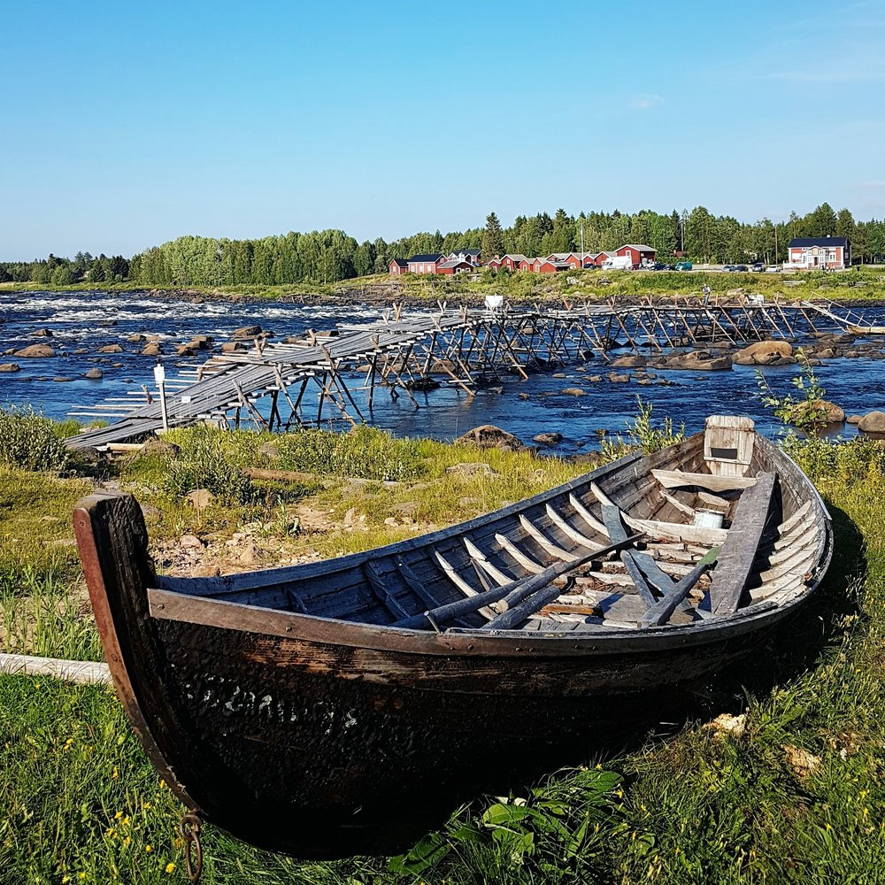 A traditional Fishing Boat stands by the waters edge. These boats are used by the local fisherman to take on the rapids and catch a great crop of White Fish and Salmon. From the rive Torne.