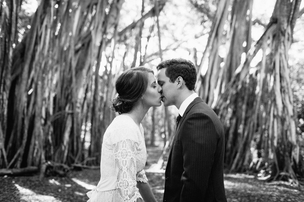 California Small Wedding Photographer Bohemian Lace Dress with Long Sleeves and Flower Crown Simple Hair Updo Navy Blue Elopement Tuxedo First Look Excitement