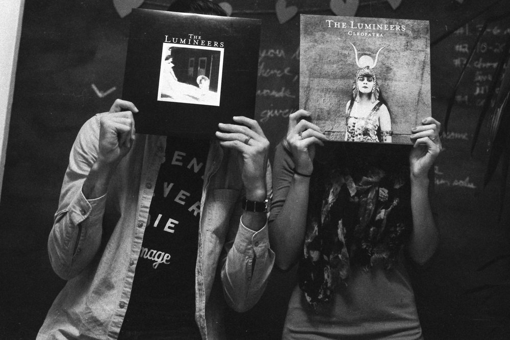 Photographs with Records in front of People