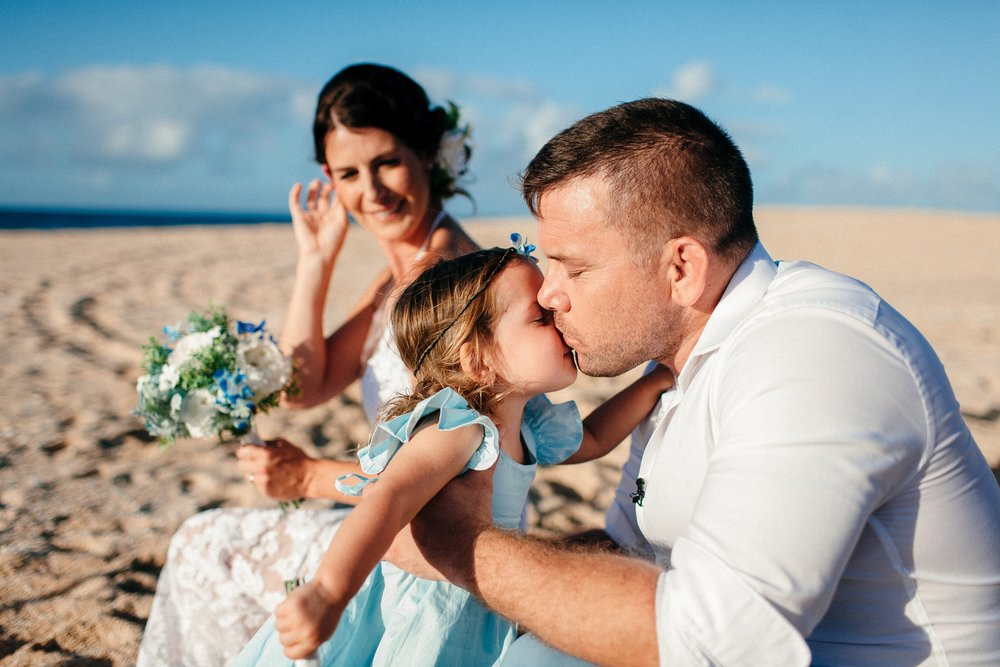 Ben kissing his daughter Lola right after he and Anna got married on the beach with just their two kids as their witnesses.