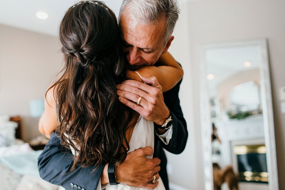 Emotional photograph of a bride and her father on her wedding day