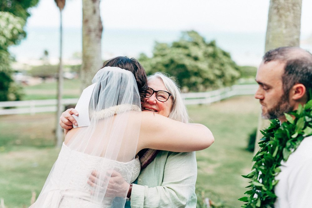 Ilima and her auntie hugging right after her vows to Chris at Kualoa Ranch in front of Chinaman's Hat
