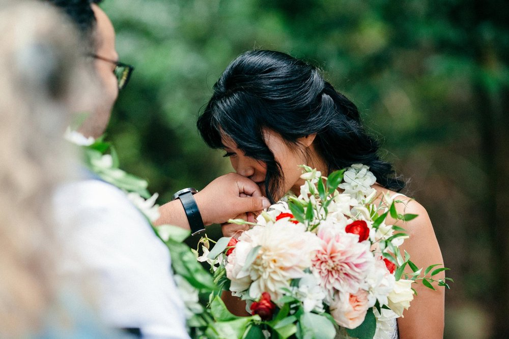 Amy & Danny during their vows to one another at their garden wedding in Maui.