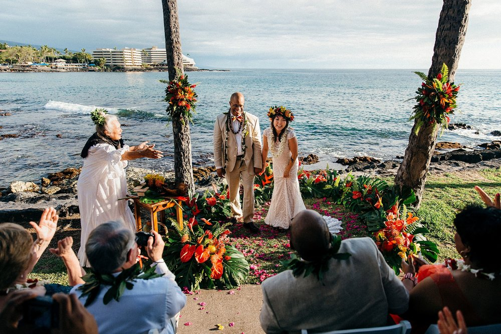 Becca & Brandon's oceanfront, non-traditional Hawaiian wedding ceremony at Daylight Mind Coffee Company in Kona.