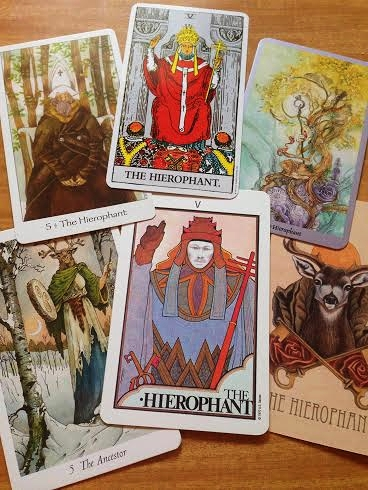 Top: Dreaming Way Hierophant, Rider Waite Hierophant, Shadowscapes Hierophant. Bottom: Wildwood Ancestor, Aquarian Tarot Hierophant, Wooden Tarot Hierophant.