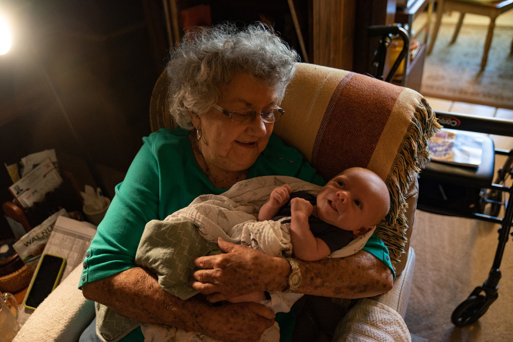 """Mimi, sitting in her """"home-chair"""" and holding her great-grandson (my sister Shelly's baby)."""
