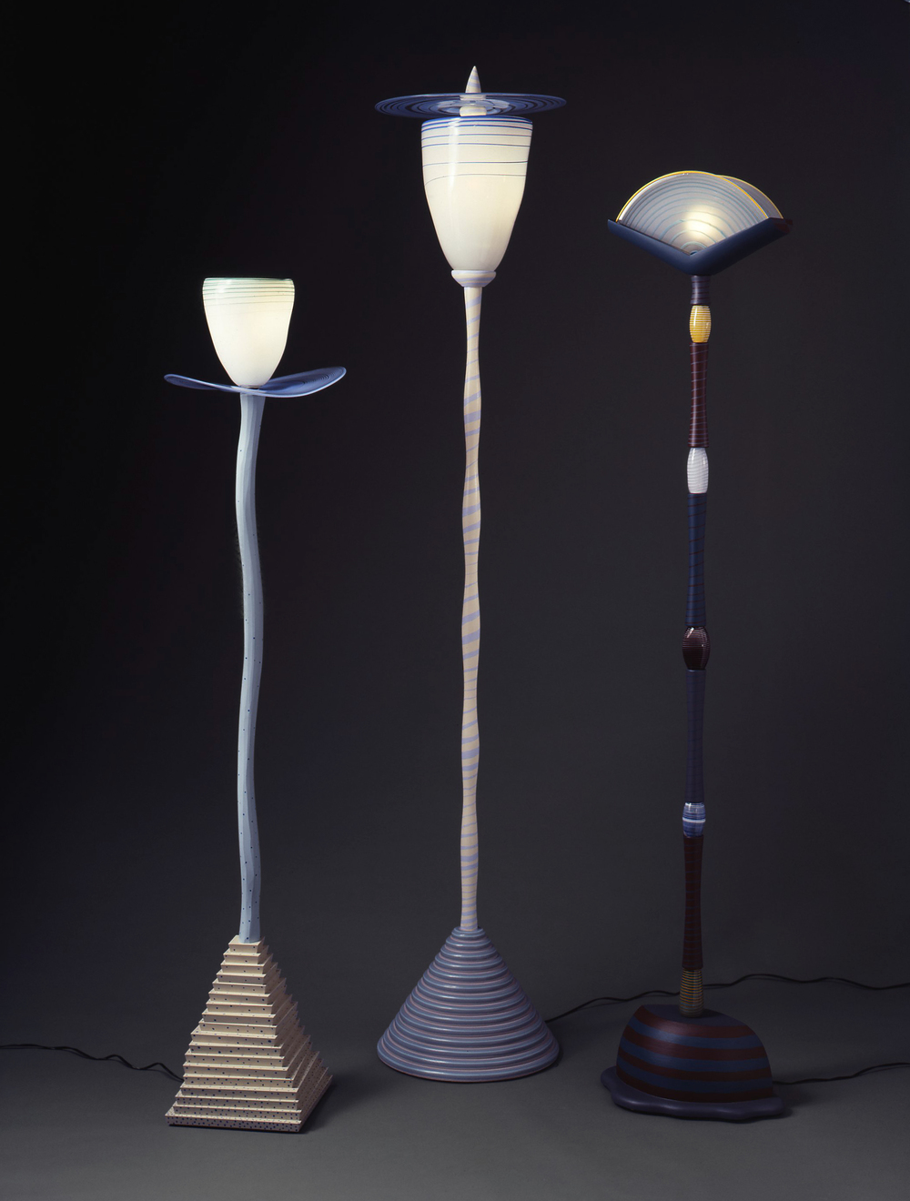 Lamps: (left to right) Cowboy Lamp, Streetlamp, Boat/Egg Lamp  I  Tom Loeser and Hank Murta Adams  I  1983  I  glass, wood, paint