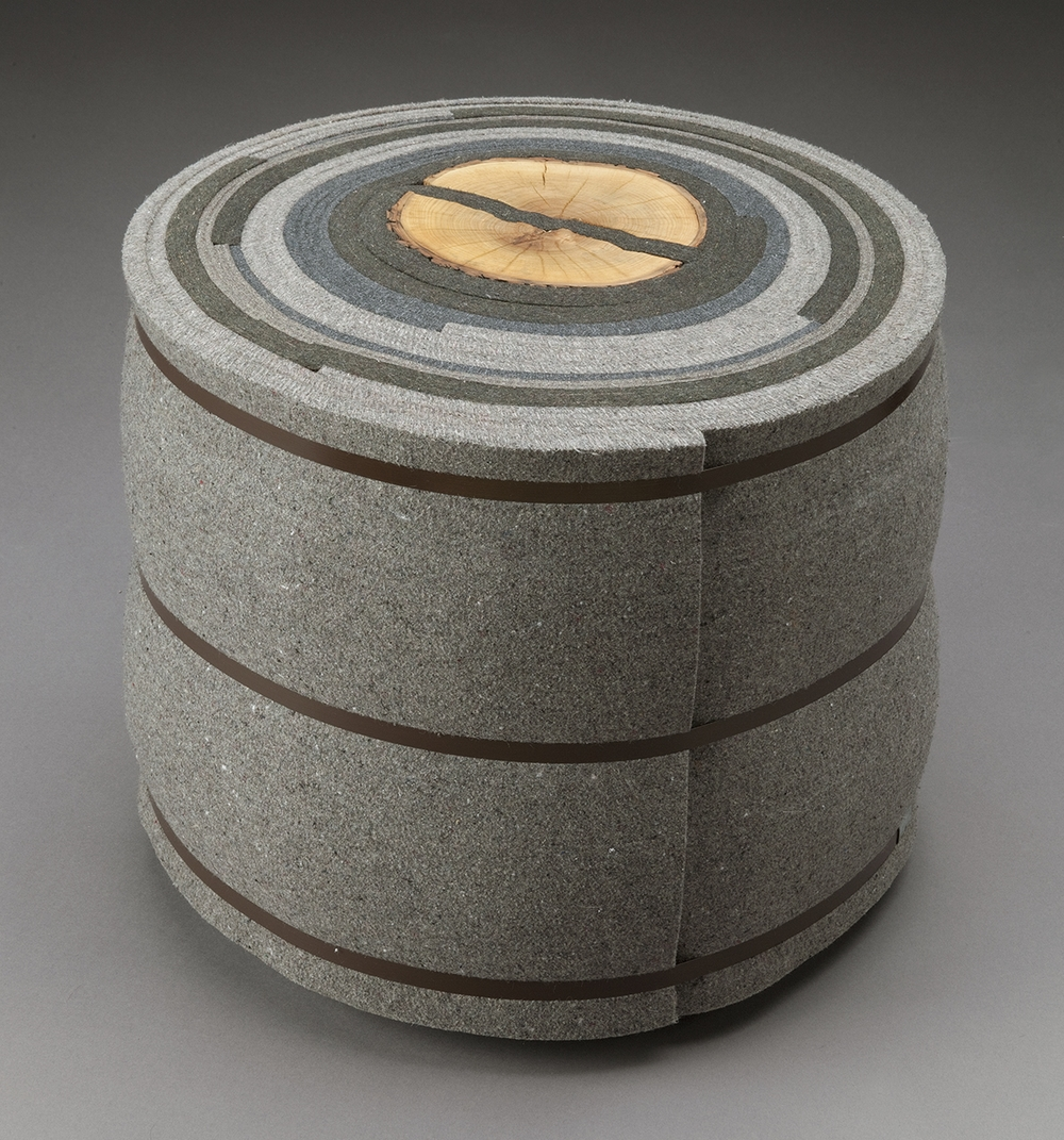 Roll Up 2  |  2007  |  felt, firewood, steel  |  16 x 19